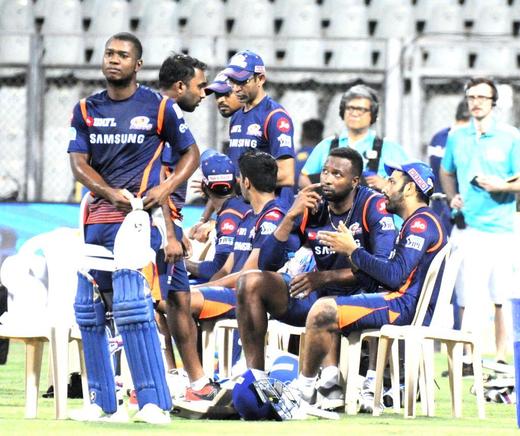Mumbai Indians players during a practice session at Wankhede Stadium in Mumbai on April 6, 2018.