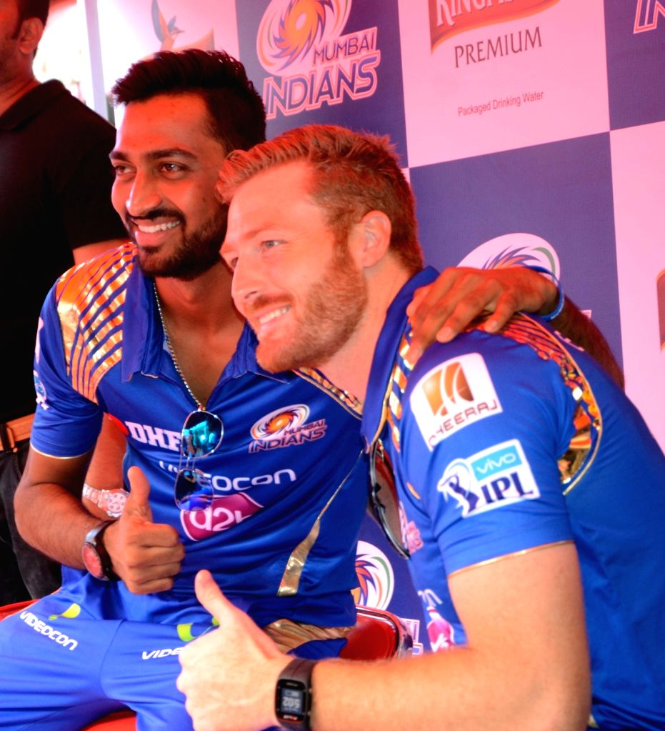 Mumbai Indians players Martin Gutpill and Krunal Pandya during a promotional event in Mumbai on May 17, 2016.