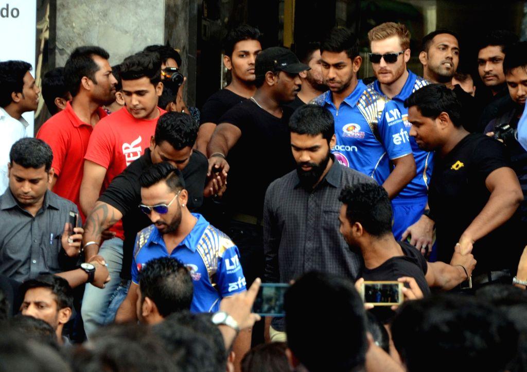 Mumbai Indians players Martin Gutpill, Krunal Pandya and Jagadeesha Suchith during a promotional event in Mumbai on May 17, 2016.