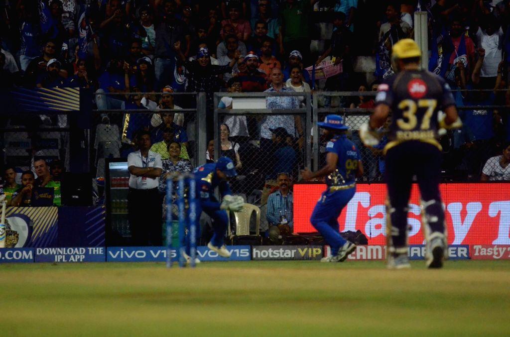 Mumbai Indians' Quinton de Kock takes the catch of Chris Lynn during the 56th match of IPL 2019 between Kolkata Knight Riders and Mumbai Indians at Wankhede Stadium in Mumbai, on May 5, 2019.
