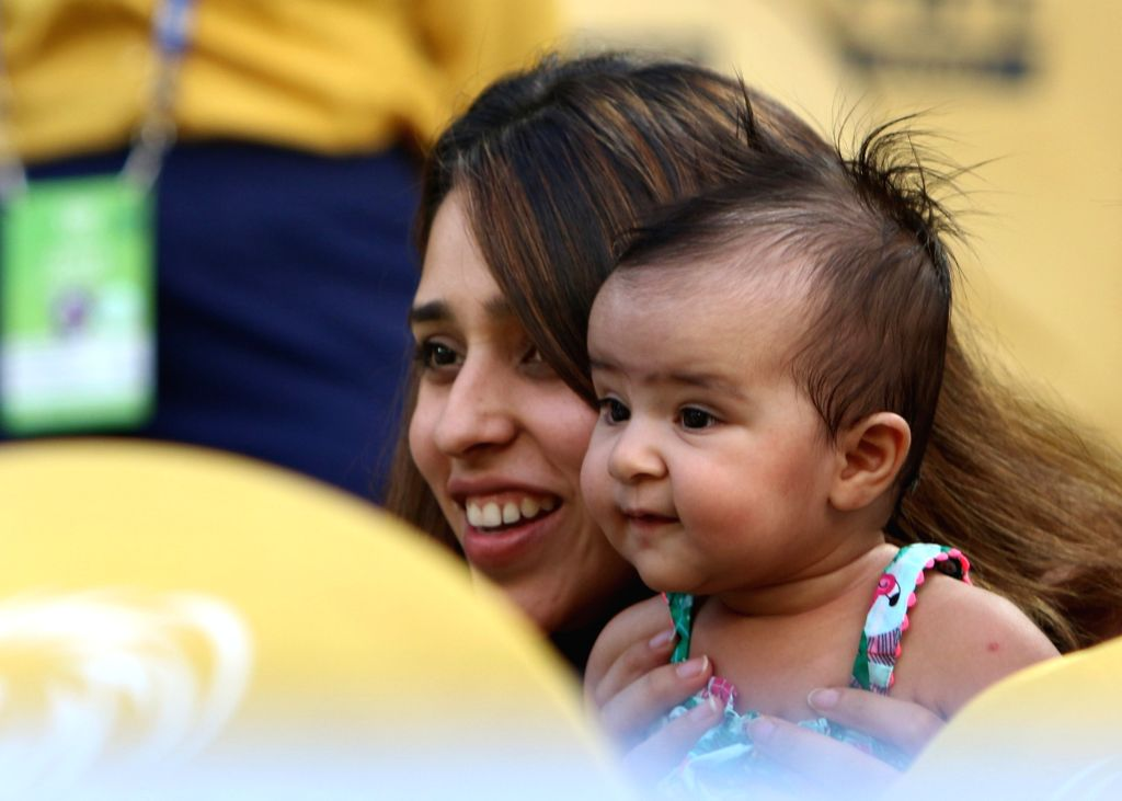 Mumbai Indians skipper Rohit Sharma's wife Ritika Sajdeh and daughter Samaira during the Final match of IPL 2019 between Chennai Super Kings and Mumbai Indians at Rajiv Gandhi ... - Rohit Sharma