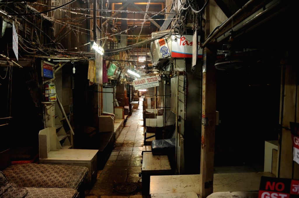 Mumbai Joint Action Committee of Textile Traders Associations observe a bandh by closing their shops in protest against the implementation of GST in Mumbai on June 27, 2017.