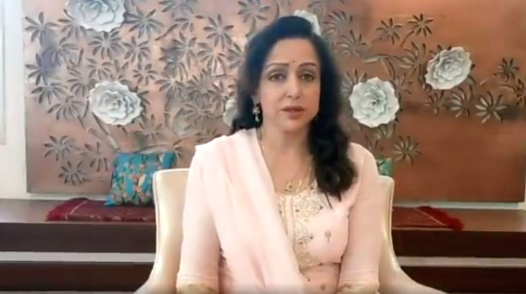 Mumbai, July 12 (IANS) Veteran actress-politician Hema Malini on Sunday posted a video to quash rumours of her ill health that started doing the rounds soon after Amitabh and Abhishek Bachchan were hospitalised with Covid infection. - Hema Malini and Abhishek Bachchan