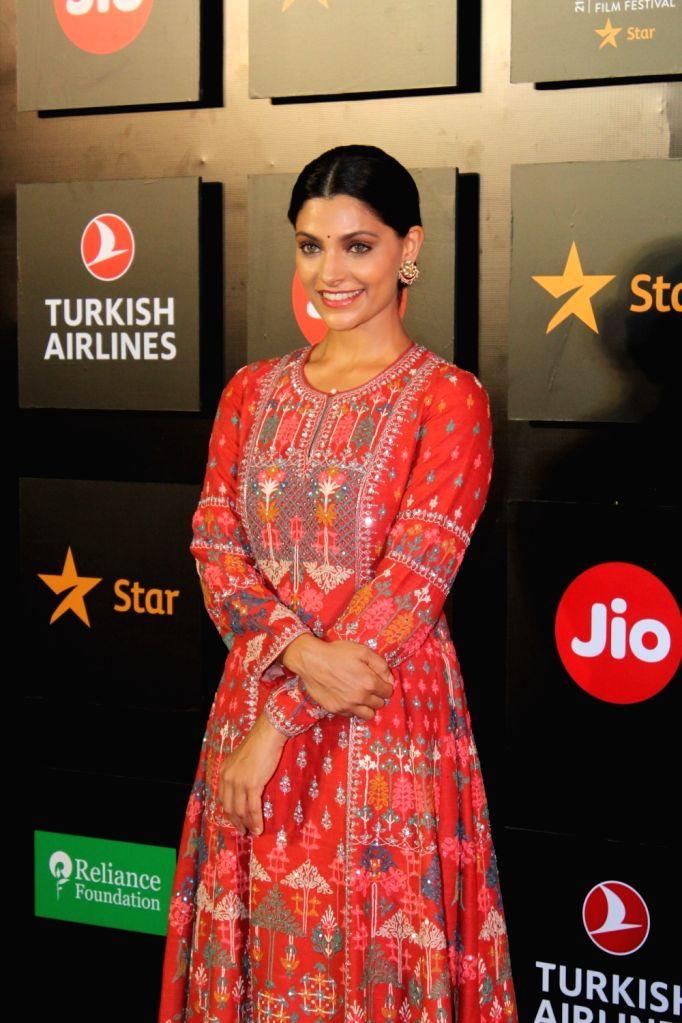"Mumbai, June 22 (IANS) Actress Saiyami Kher has received positive reviews for her performance in the new digital film ""Choked: Paisa Bolta Hai"", directed by Anurag Kashyap . - Saiyami Kher and Anurag Kashyap"