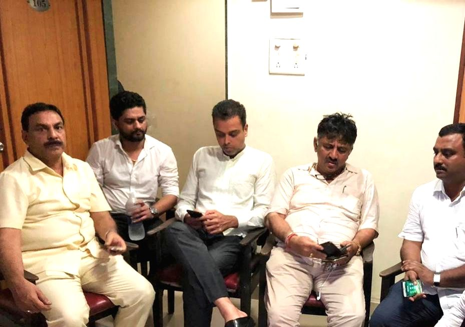 Mumbai: Karnataka Minister D.K. Shivakumar and Congress leaders Naseem Khan and Milind Deora under detention at Kalina University rest house, in Mumbai on July 10, 2019. (Photo: IANS) - D. and Naseem Khan