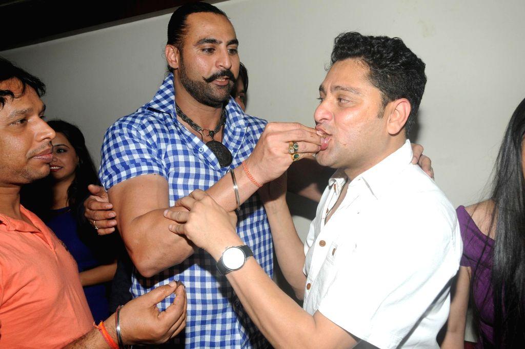 Kaushik Banerjee with Harry Josh during the birthyday of director Kaushik Banerjee in Mumbai on Jan 10, 2015.