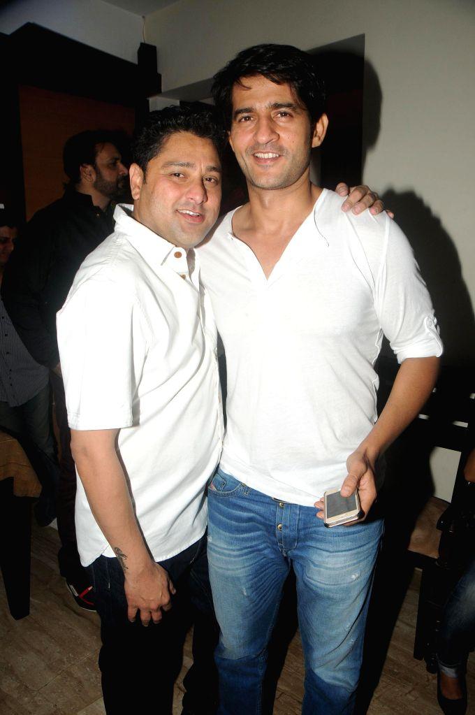 Kaushik Banerjee with Hiten Tejwani during the birthyday of director Kaushik Banerjee in Mumbai on Jan 10, 2015.