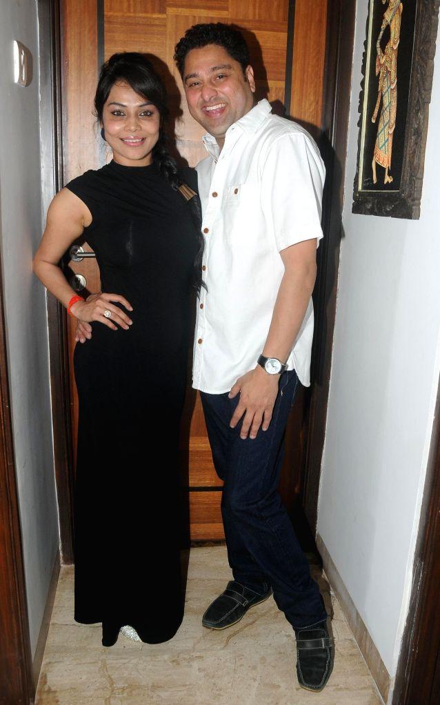 Kaushik Banerjee with Nikita Rawal during the birthyday of director Kaushik Banerjee in Mumbai on Jan 10, 2015.