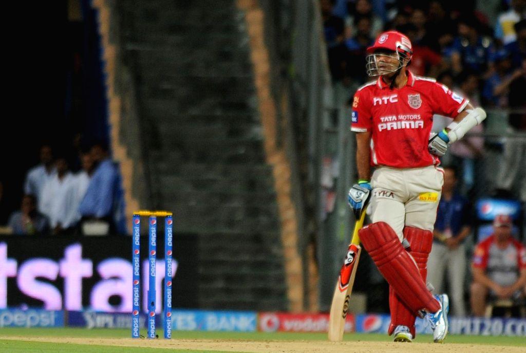 Kings XI Punjab batsman Virender Sehwag during an IPL-2015 match between Mumbai Indians and Kings XI Punjab at Wankhede Stadium, in Mumbai, on April 12, 2015. - Virender Sehwag