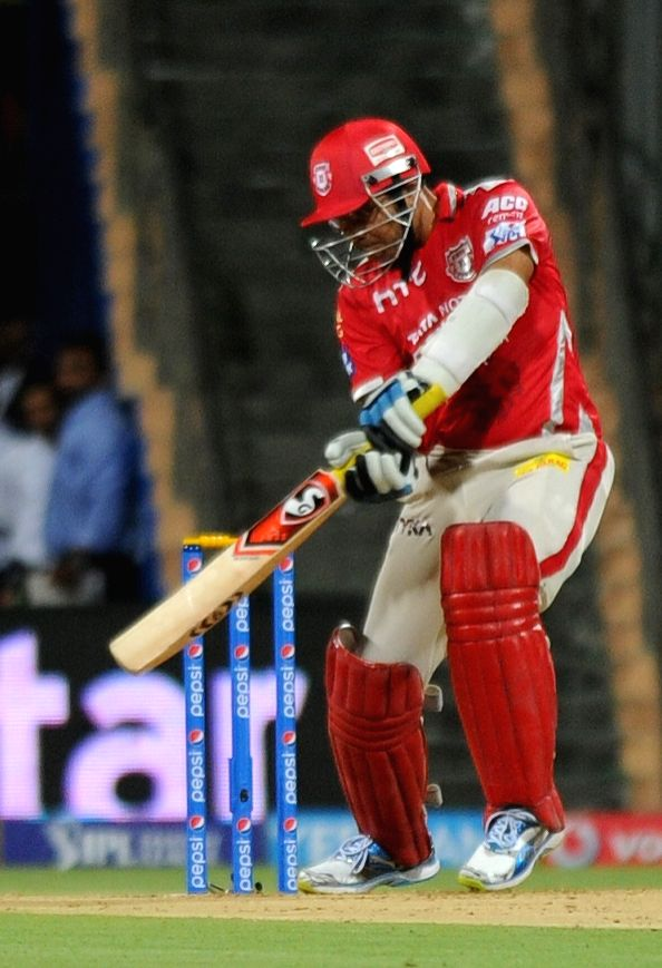 Kings XI Punjab batsman Virender Sehwag in action during an IPL-2015 match between Mumbai Indians and Kings XI Punjab at Wankhede Stadium, in Mumbai, on April 12, 2015. - Virender Sehwag