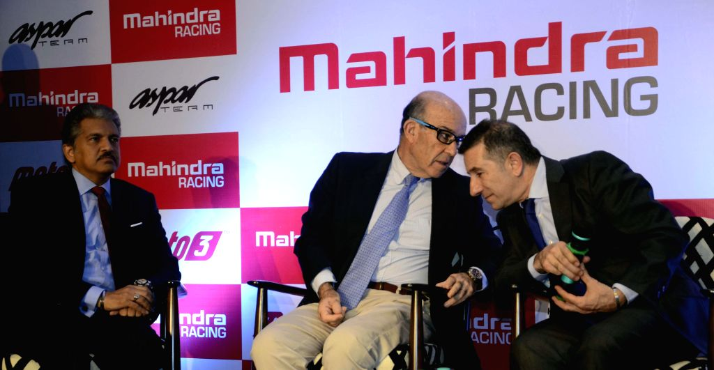 (L to R) Chairman, Mahindra Group, Anand Mahindra, CEO of MotoGP right-holder Dorma Sports, Camelo Ezpeleta  and CEO of Mahindra Racing`s new partner, the Asper Team, Jorge Martinez during a .