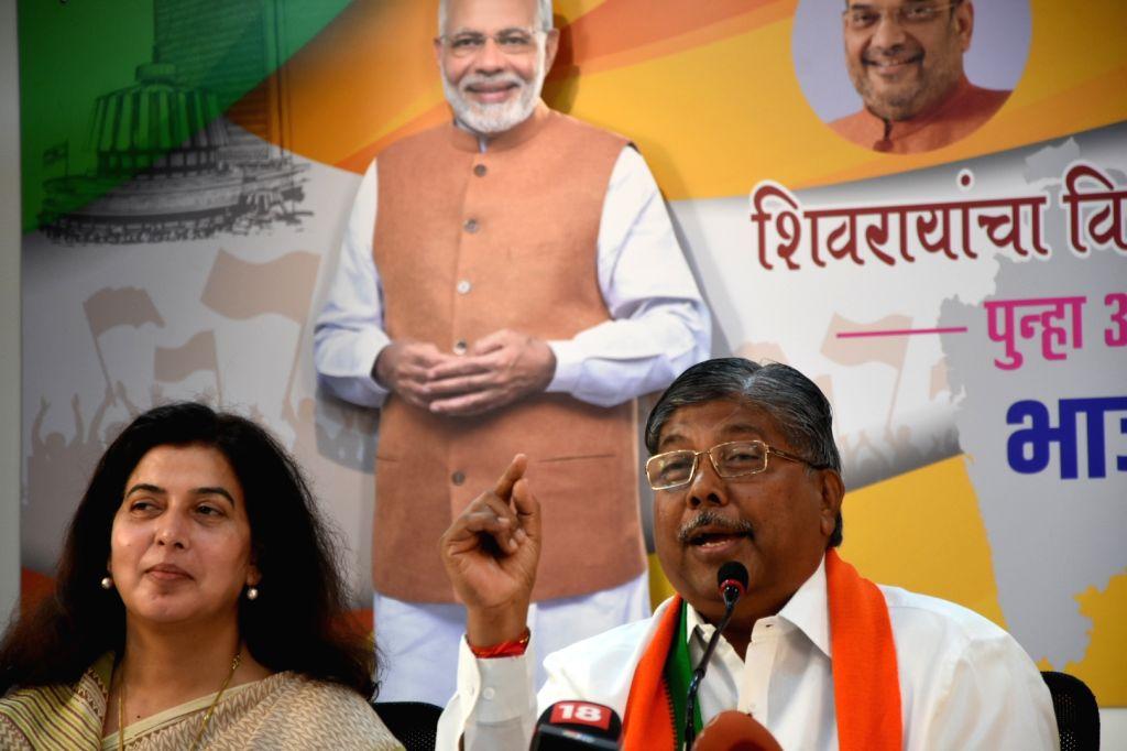 Mumbai: Maharashtra BJP President Chandrakant Patil addresses a press conference in Mumbai, on Sep 24, 2019. (Photo: IANS) - Chandrakant Patil