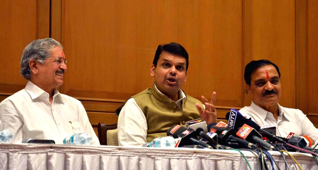 Maharashtra Chief Minister Devendra Fadnavis with Shiv Sena leaders Subhas Desai and Divakar Ravate, and others after a press conference in Mumbai, on Dec 4, 2014. - Devendra Fadnavis and Subhas Desai