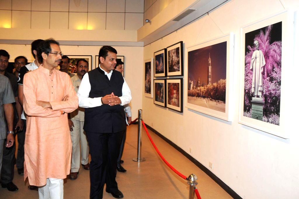 Maharashtra Chief Minister Devendra Fadnavis and Shiv Sena Chief Uddhav Thackeray at latters photography exhibition organised to raise funds for drought affected farmers, in Mumbai, on Jan 9, - Devendra Fadnavis
