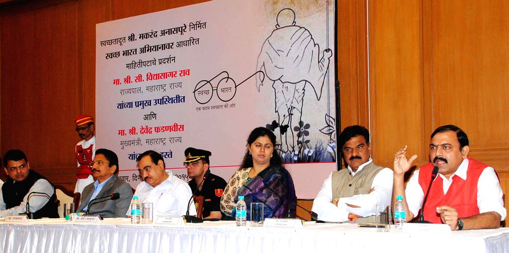 Maharashtra Chief Minister Devendra Fadnavis during the launch of `Clean India Campaign documentary` produced by actor Makrand Anaspure in Mumbai on Feb. 4, 2015. Also seen Maharashtra ... - Devendra Fadnavis and Chennamaneni Vidyasagar Rao