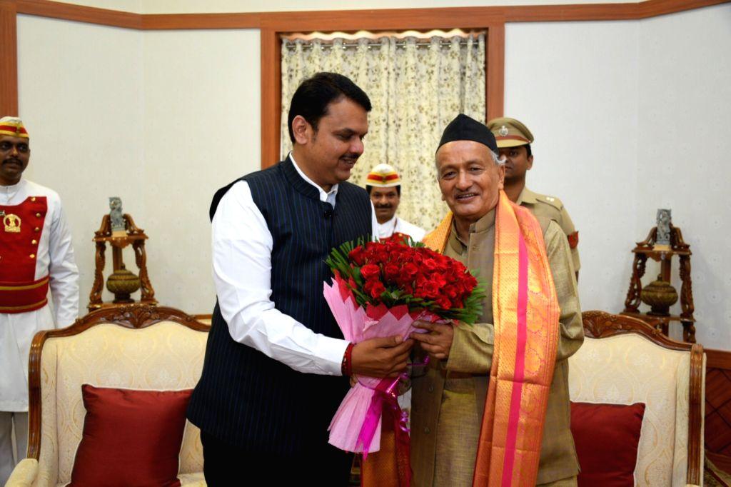 Mumbai: Maharashtra Chief Minister Devendra Fadnavis meets Governor B. S. Koshyari at the Raj Bhavan in Mumbai on Oct 28, 2019. (Photo: IANS) - Devendra Fadnavis