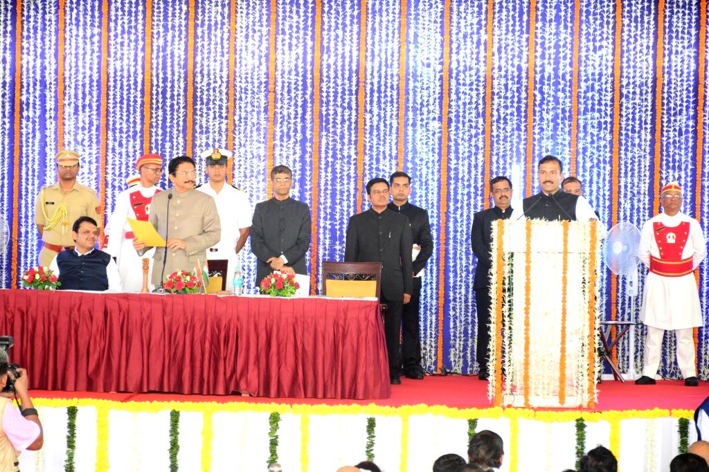 Mumbai: Maharashtra Governor CH Vidyasagar Rao in the presence Chief Minister Devendra Fadnavis, administers the oath of office to Bala Bhegade as a Cabinet Minister during a swearing-in ceremony, in Mumbai, on June 16, 2019. (Photo: IANS) - Devendra Fadnavis and Vidyasagar Rao