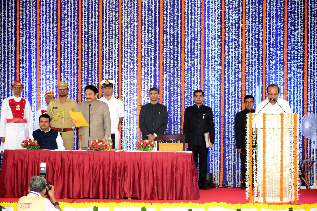 Mumbai: Maharashtra Governor CH Vidyasagar Rao in the presence Chief Minister Devendra Fadnavis, administers the oath of office to former Congress leader Radhakrishna Vikhe-Patil as a Cabinet Minister during a swearing-in ceremony, in Mumbai, on June - Devendra Fadnavis, Vidyasagar Rao and Radhakrishna Vikhe-Patil
