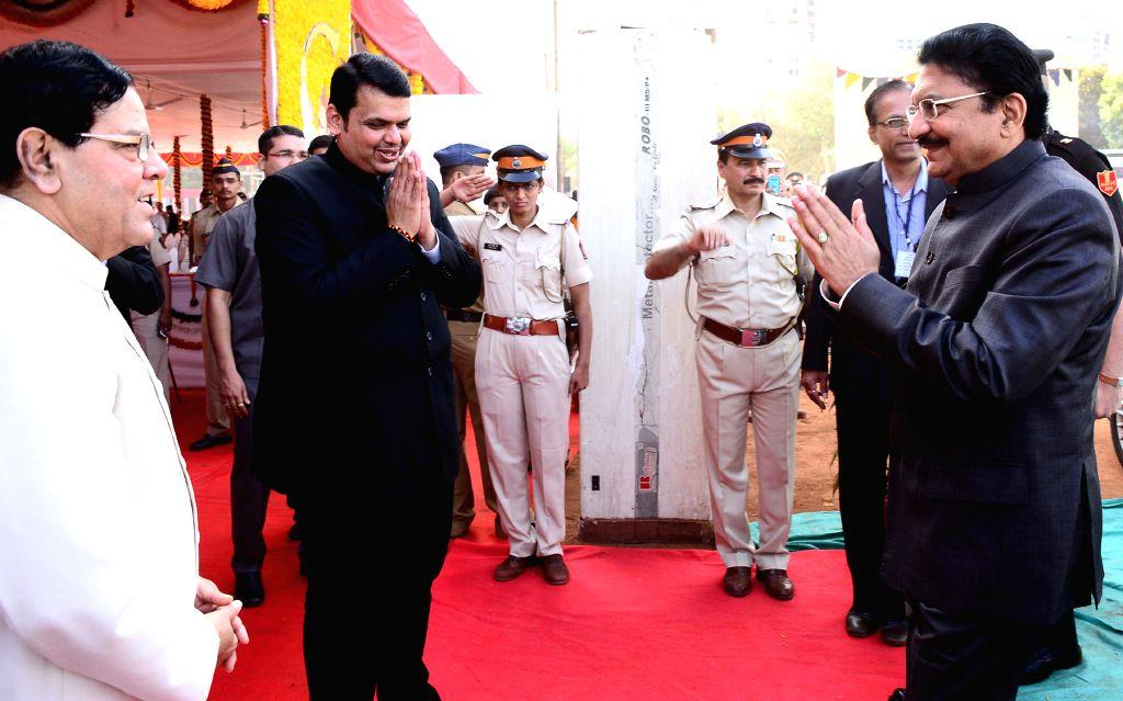 Maharashtra Governor Chennamaneni Vidyasagar Rao and Chief Minister Devendra Fadnavis during a programme organised on Maharashtra Day in Mumbai, on May 1, 2015. - Devendra Fadnavis and Chennamaneni Vidyasagar Rao