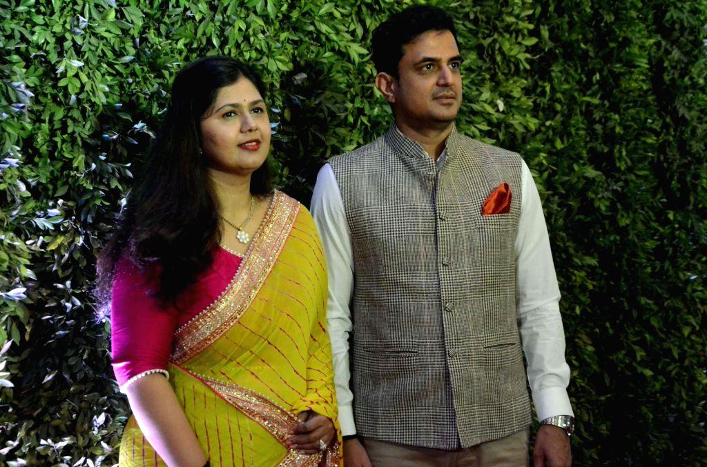 Mumbai: Maharashtra Minister Pankaja Munde with her husband Amit Palwe at Maharashtra Navnirman Sena (MNS) chief Raj Thackeray's son Amit Thackeray's wedding reception in Mumbai, on Jan 27, 2019. (Photo: IANS) - Pankaja Munde