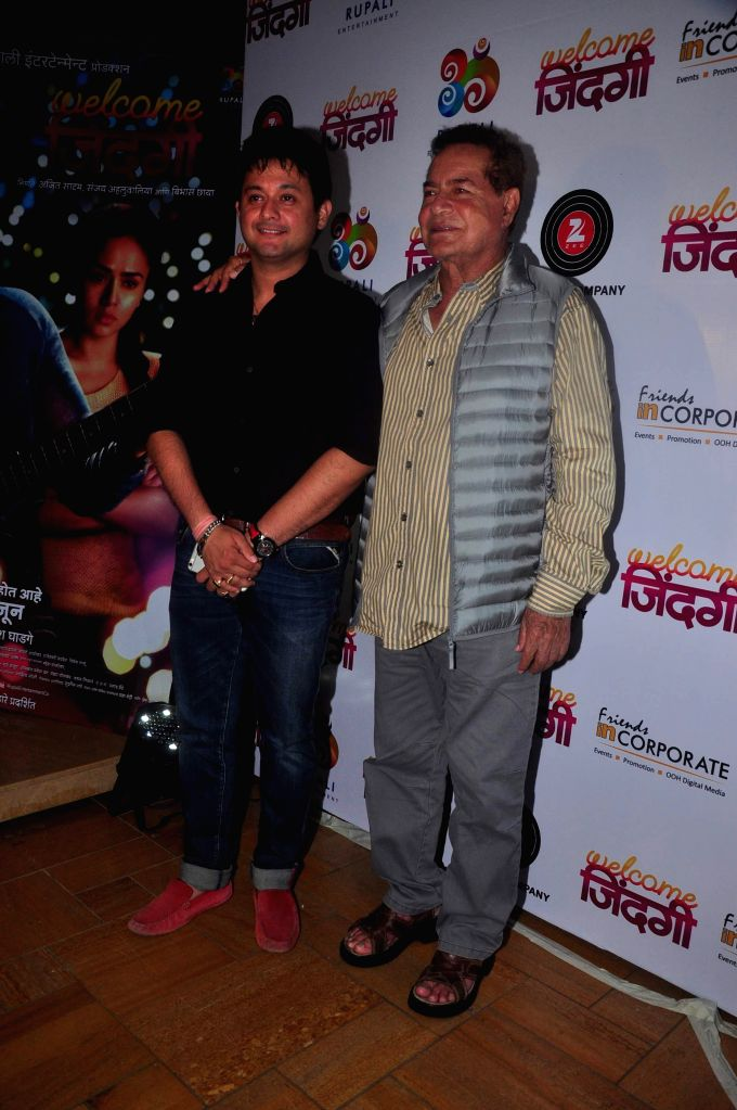 Marathi actor Swapnil Joshi and screenplay writer Salim Khan during the first look and music launch of Marathi film Welcome Zindagi in Mumbai, on May 2, 2015. - Swapnil Joshi and Khan