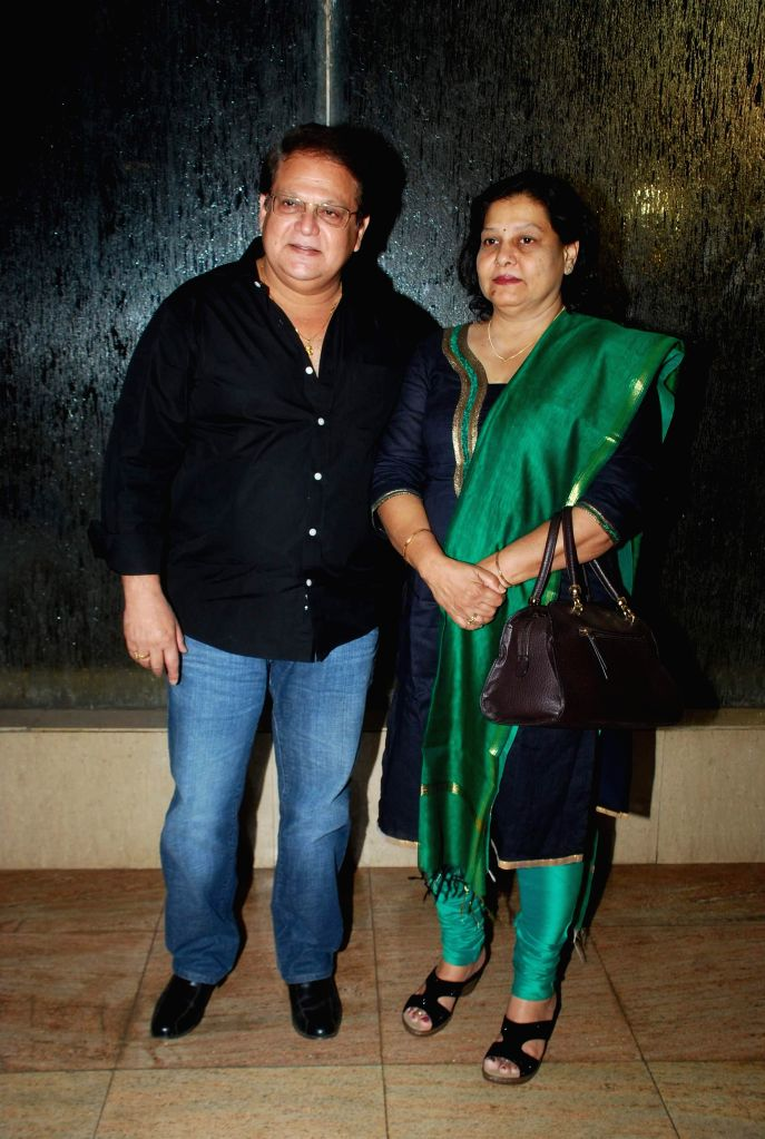 Marathi film actor Mahesh Kothare with his wife during the music launch of Marathi film Kaakan in Mumbai on March 11, 2015. - Mahesh Kothare