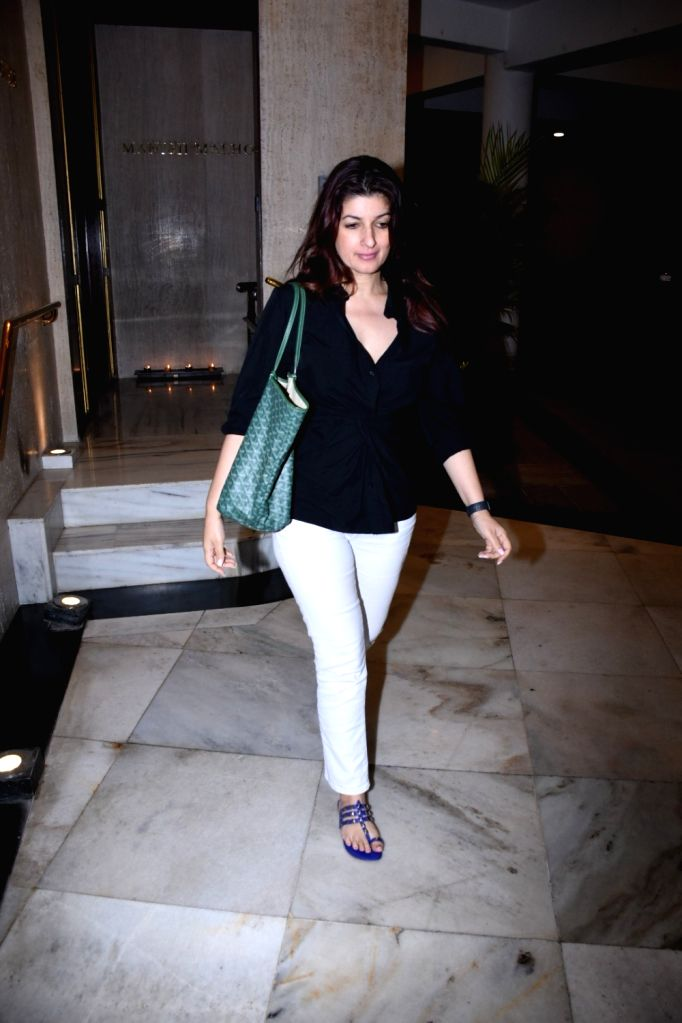 Mumbai, March 30 (IANS) Author-producer Twinkle Khanna recently broke a foot, and her little daughter Nitara, is trying her best to turn Twinkle's plaster into a canvas.(File Photo: IANS) - Khanna