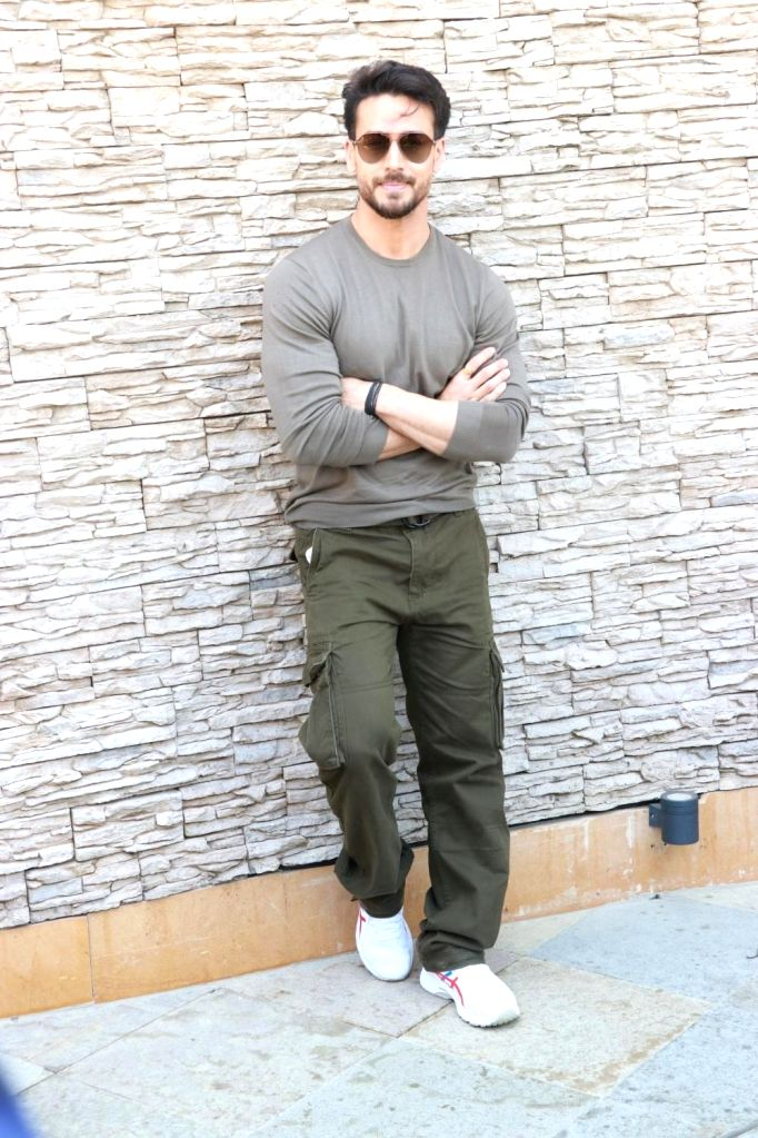 Mumbai, March 30 (IANS) Unable to hit the gym owing to the lockdown, Bollywood star Tiger Shroff has taken to playing football at home, besides of course keeping up with his workout regime. (File Photo: IANS)