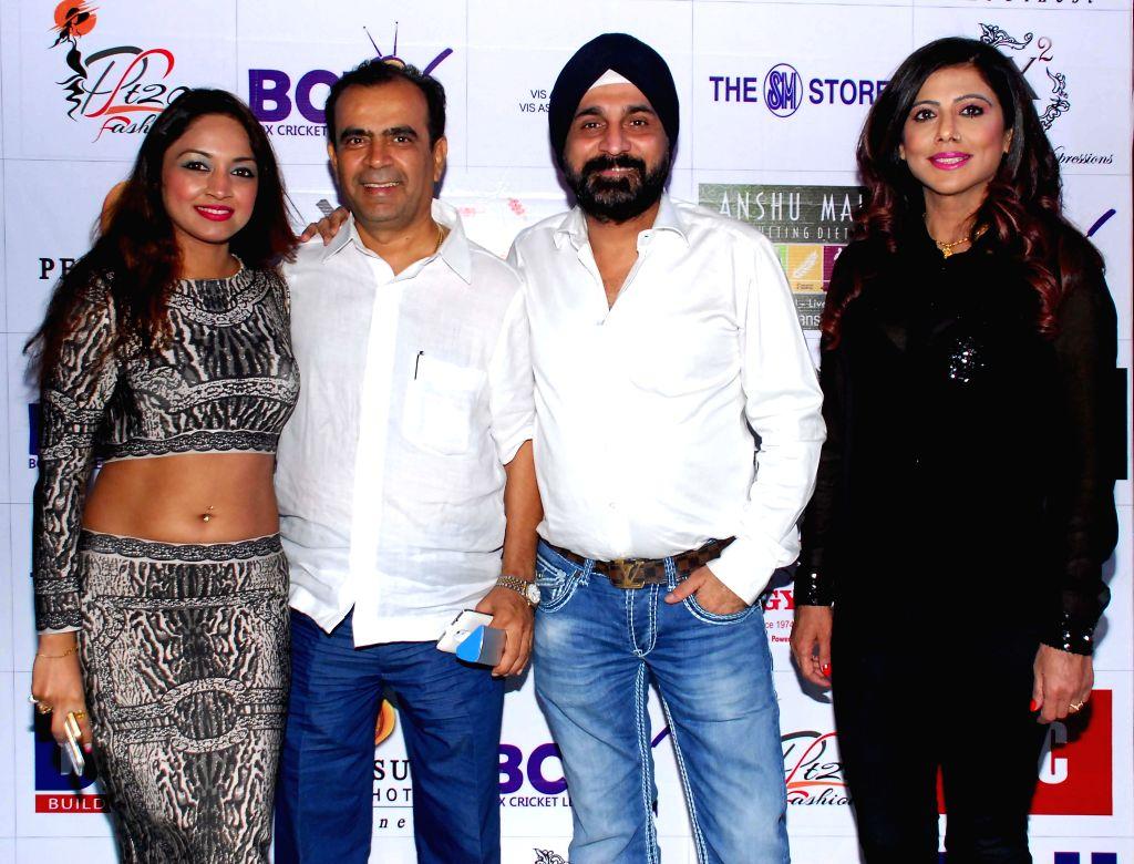 Marisa Verma, Yogesh Lakhani, Raj Suri & Tinaa Ghaai during the launch of Dress and anthem of BCL team Kolkatta Babu Moshai at Peninsula Grand in Mumbai, on November 20, 2014. - Marisa Verma