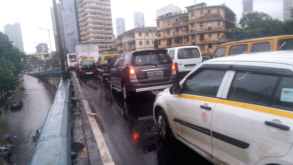 Mumbai: Massive traffic jam near Elphinstone Road after heavy rains left Mumbai streets water-logged, on July 1, 2019. (Photo: IANS)