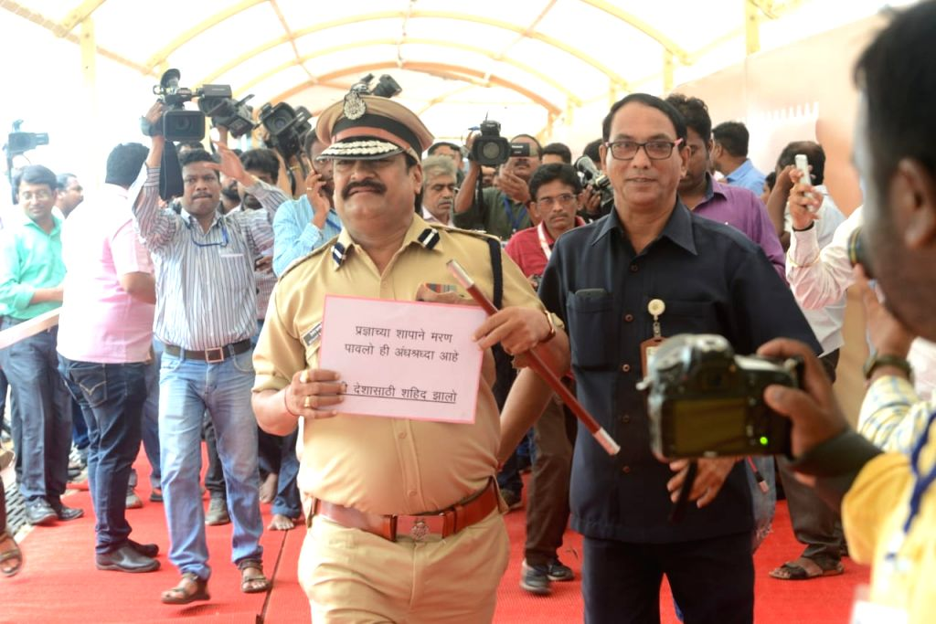 "Mumbai: Maverick Nationalist Congress Party legislator Prakash Gajbhiye arrives at the Maharashtra Legislature dressed up like the former slain top cop, Hemant Karkare, on June 26, 2019. Carrying a placard, he moved around silently to ""express regret - Pragya Singh Thakur"