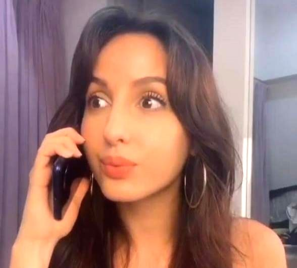 """Mumbai, May 25 (IANS) Dancer and Bollywood actress Nora Fatehi is """"grateful for being alive and healthy"""" in this """"crazy time"""". On the occasion of Eid this year, the actress is praying for """"peace, good health and happiness"""" for everyone. - Nora Fatehi"""