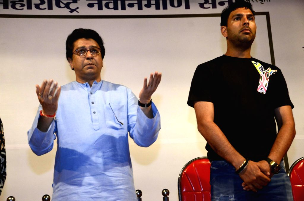 MNS chief Raj Thackeray and Indian cricketer Yuvraj Singh during a cancer awareness programme in Mumbai, on March 8, 2015.