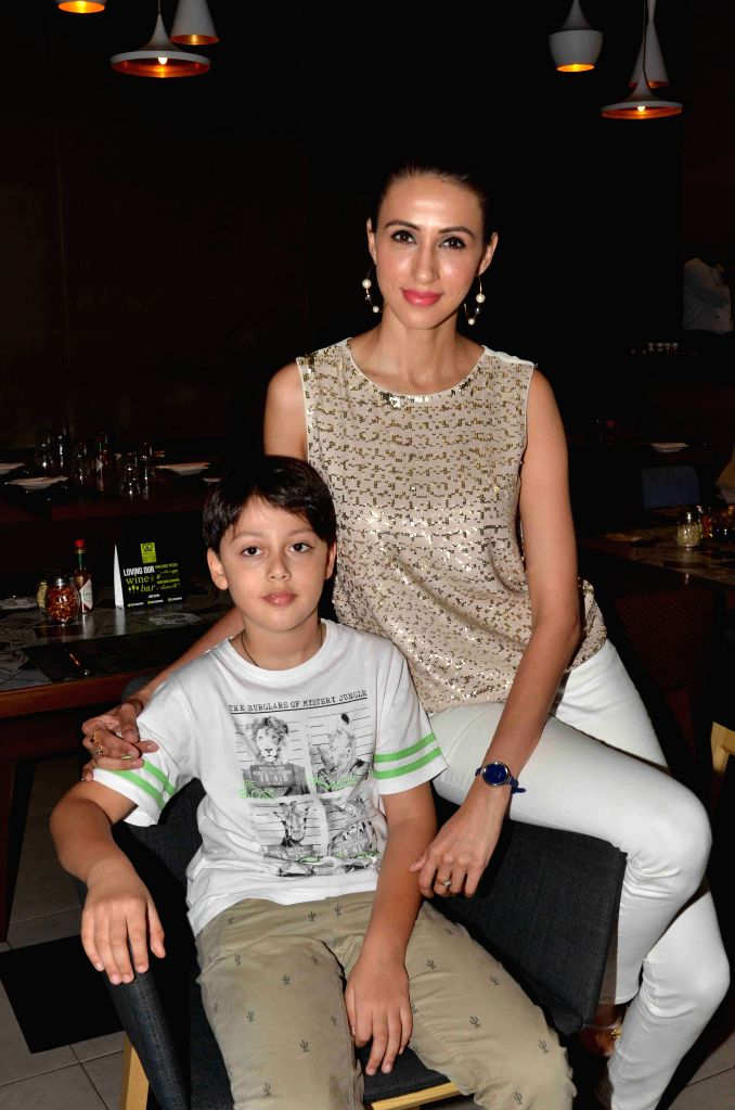 Model Alesia Raut with her son during the launch of Shine Young 2015 in Mumbai on 4th May 2015 - Alesia Raut