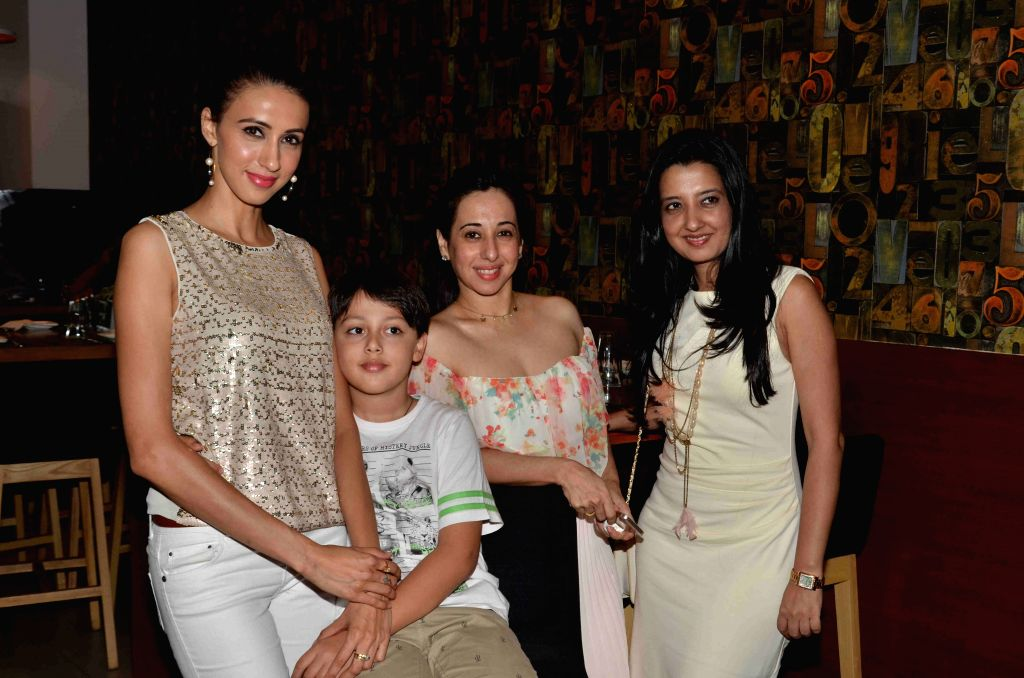 Model Alesia Raut with her son Mark, model Aditi Gowitrikar and fashion designer Amy Billimoria during the launch of Shine Young 2015 in Mumbai on 4th May 2015 - Alesia Raut