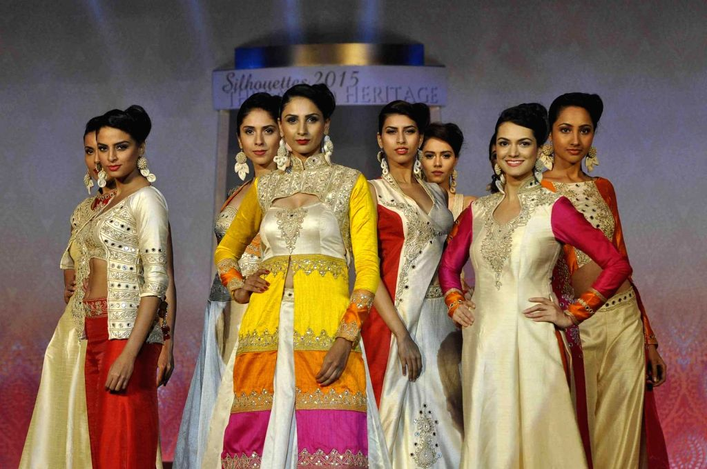 Models walk on the ramp during the Silhouettes 2015, annual fashions show of B D Somani institute Art & Fashion, in Mumbai, on May 3, 2015.