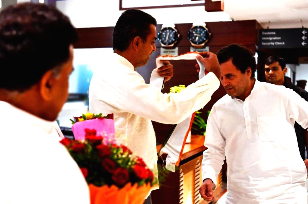Mumbai: Mumbai Congress President Milind Deora welcomes former Congress President Rahul Gandhi on his arrival in Mumbai, on July 4, 2019. Rahul Gandhi will appear before Mumbai Court in connection with a defamation case filed by a Rashtriya Swayamsev - Rahul Gandhi