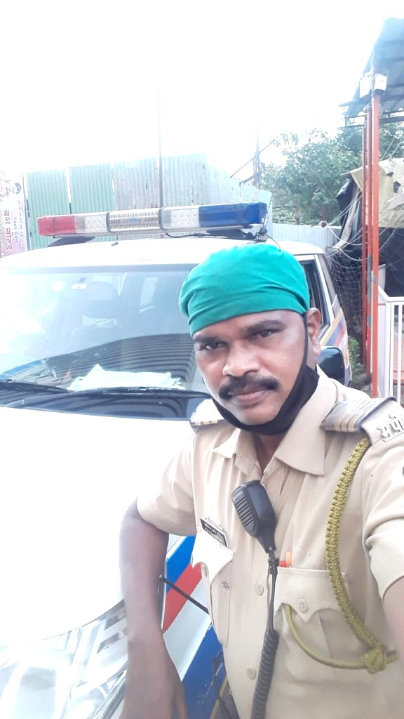 Mumbai: Mumbai cop Abhiman More of Kasturba Road Police Station, Borivali, jumped into the swirling 30-feet deep waters of Mithi River to save a drowning woman, around noon. (Photo: IANS)