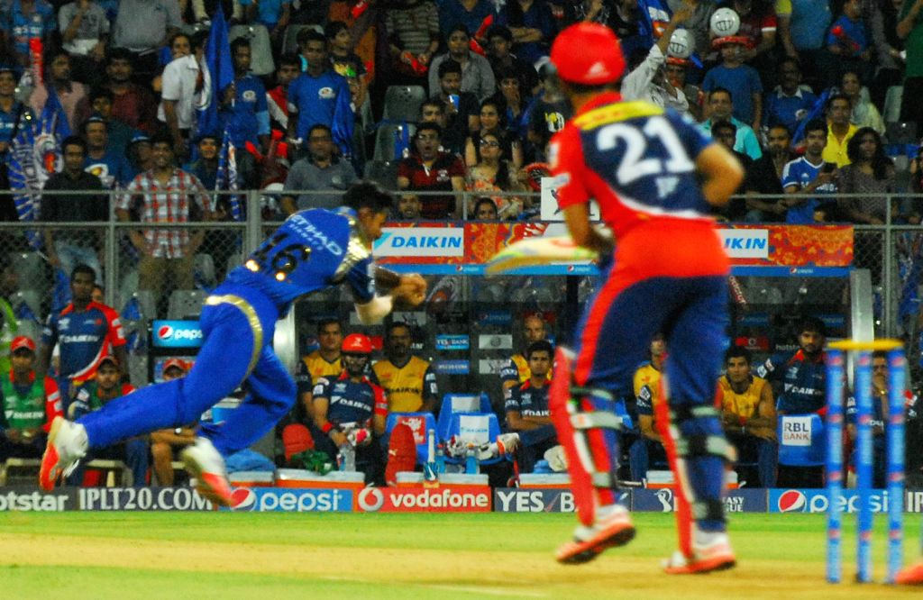 Mumbai Indians bowler Jagadeesha Suchitch dismisses JP Duminy's during an IPL 2015 match between Mumbai Indians and Delhi Daredevils at the Wankhede Stadium in Mumbai on May 5, 2015. - Jagadeesha Suchitch
