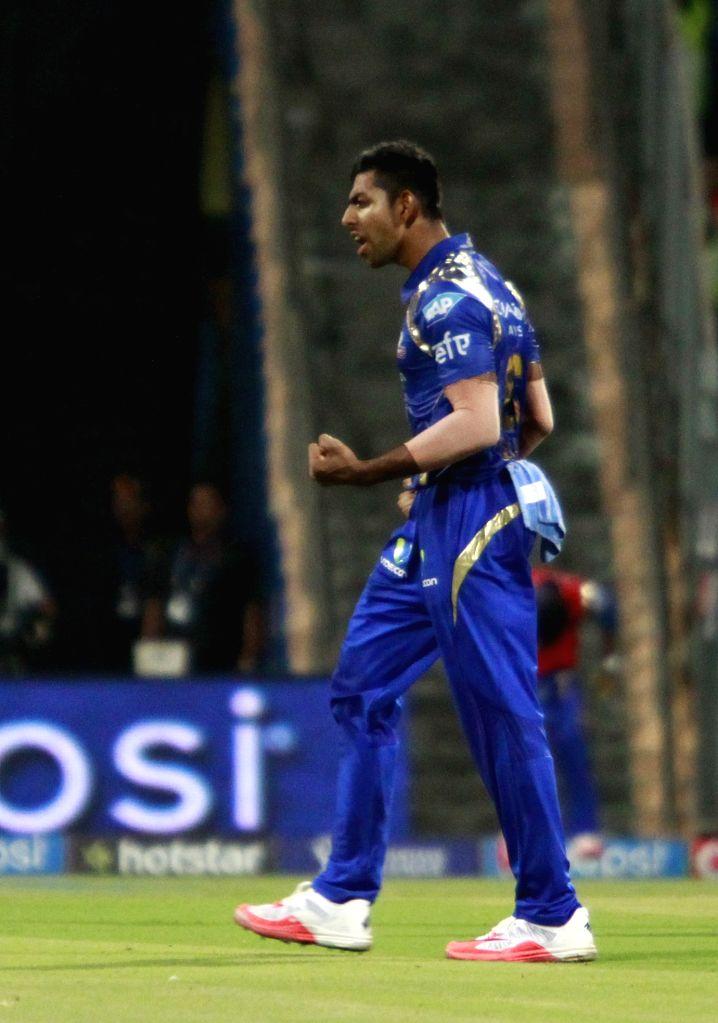 Mumbai Indians bowler Jagadeesha Suchith celebrates fall of a wicket during an IPL 2015 match between Rajasthan Royals and Mumbai Indians at the Wankhede Stadium in Mumbai, on May 1, 2015. - Jagadeesha Suchith