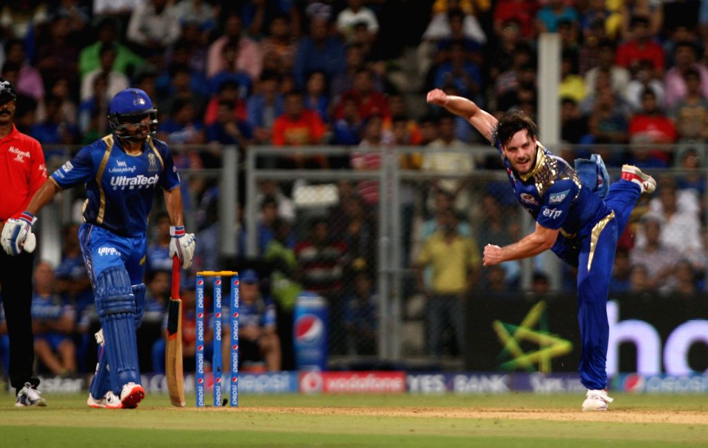 Mumbai Indians bowler Mitchell McClenaghan in action during an IPL 2015 match between Rajasthan Royals and Mumbai Indians at the Wankhede Stadium in Mumbai, on May 1, 2015. - Mitchell M