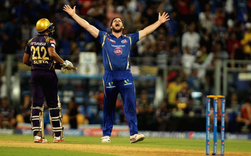 Mumbai Indians bowler Mitchell McClenaghan celebrates fall of Suryakumar Yadav's wicket during an IPL 2015 match between Mumbai Indians and Kolkata Knight Riders at Wankhede Stadium in Mumbai ... - Mitchell M and Suryakumar Yadav