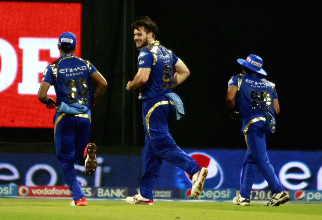 Mumbai Indians celebrate fall of a wicket during an IPL 2015 match between Rajasthan Royals and Mumbai Indians at the Wankhede Stadium in Mumbai, on May 1, 2015.