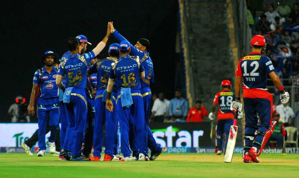 Mumbai Indians celebrate fall of a wicket during an IPL 2015 match between Mumbai Indians and Delhi Daredevils at the Wankhede Stadium in Mumbai on May 5, 2015.