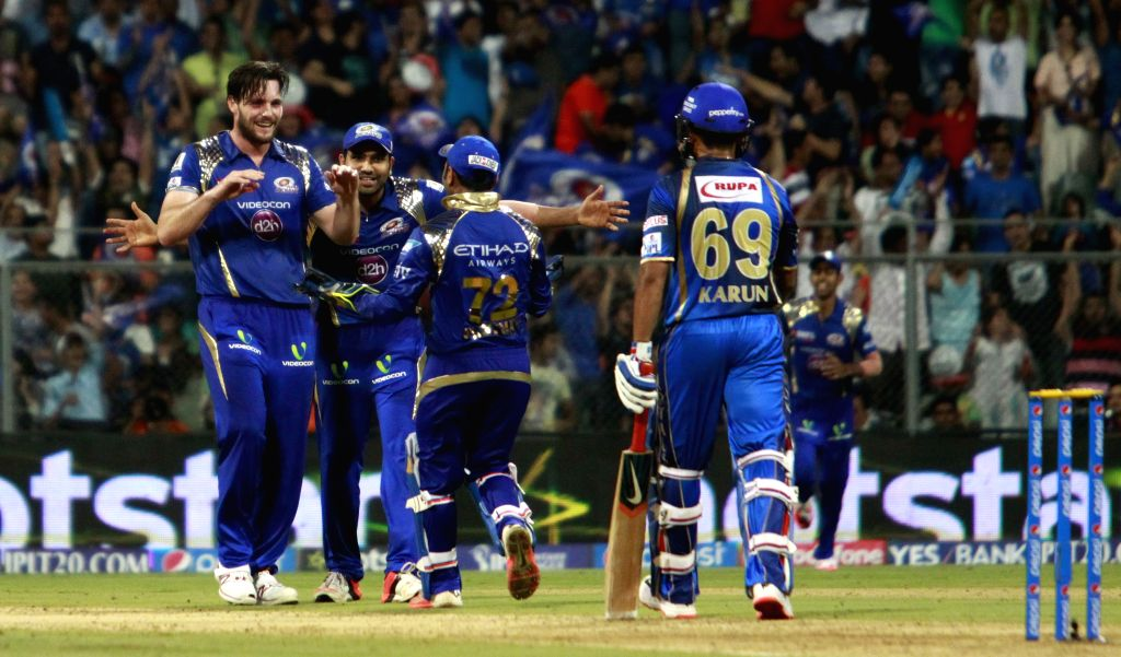 Mumbai Indians celebrate fall of Karun Nairs wicket during an IPL 2015 match between Rajasthan Royals and Mumbai Indians at the Wankhede Stadium in Mumbai, on May 1, 2015.