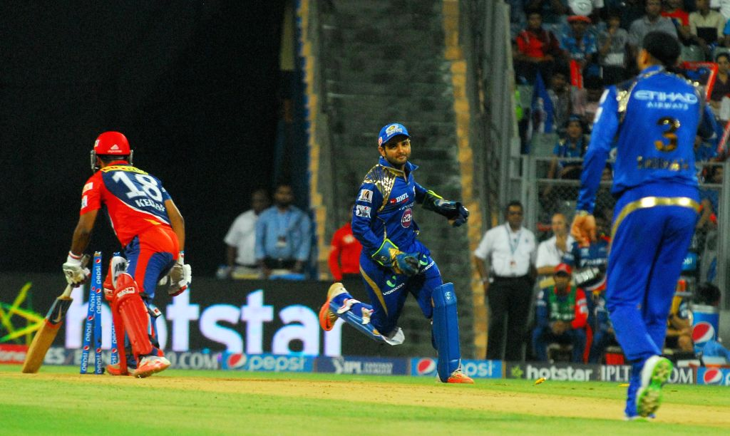 Mumbai Indians celebrate fall of Kedar Jadhav's wicket during an IPL 2015 match between Mumbai Indians and Delhi Daredevils at the Wankhede Stadium in Mumbai on May 5, 2015.