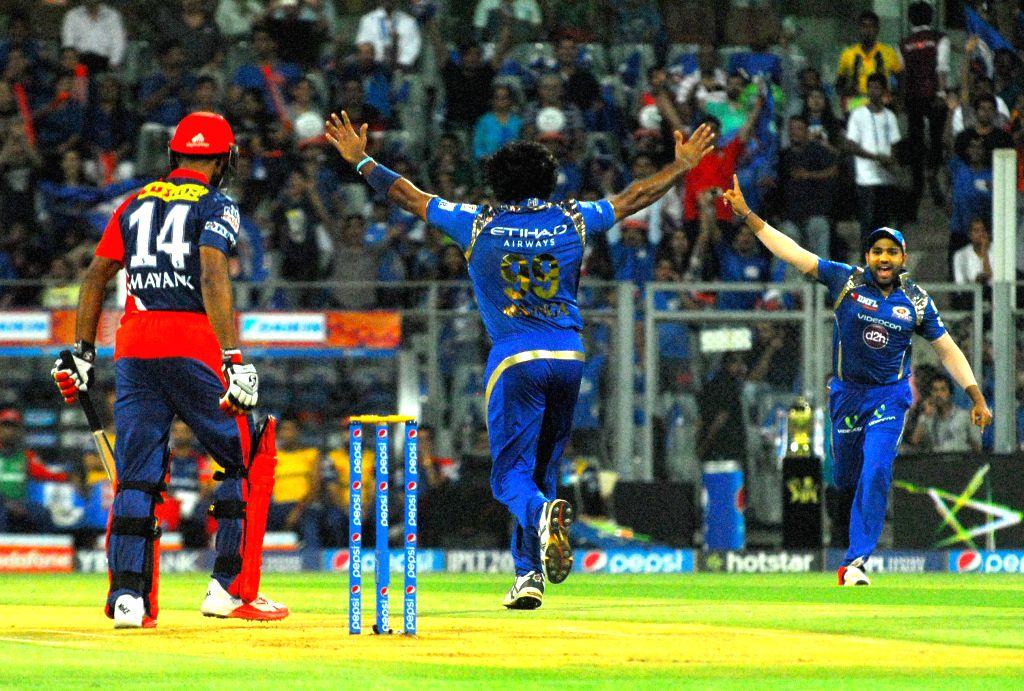 Mumbai Indians celebrate fall of Mayank Agarwal's wicket during an IPL 2015 match between Mumbai Indians and Delhi Daredevils at the Wankhede Stadium in Mumbai on May 5, 2015.
