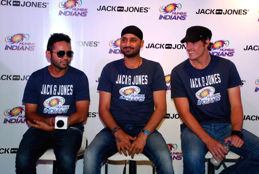 Mumbai Indians cricket players Parthiv Patel, Harbhajan Singh and Marchant de Lange at Jack and Jones store during their visit in Mumbai on, April 29, 2015. - Parthiv Patel and Harbhajan Singh