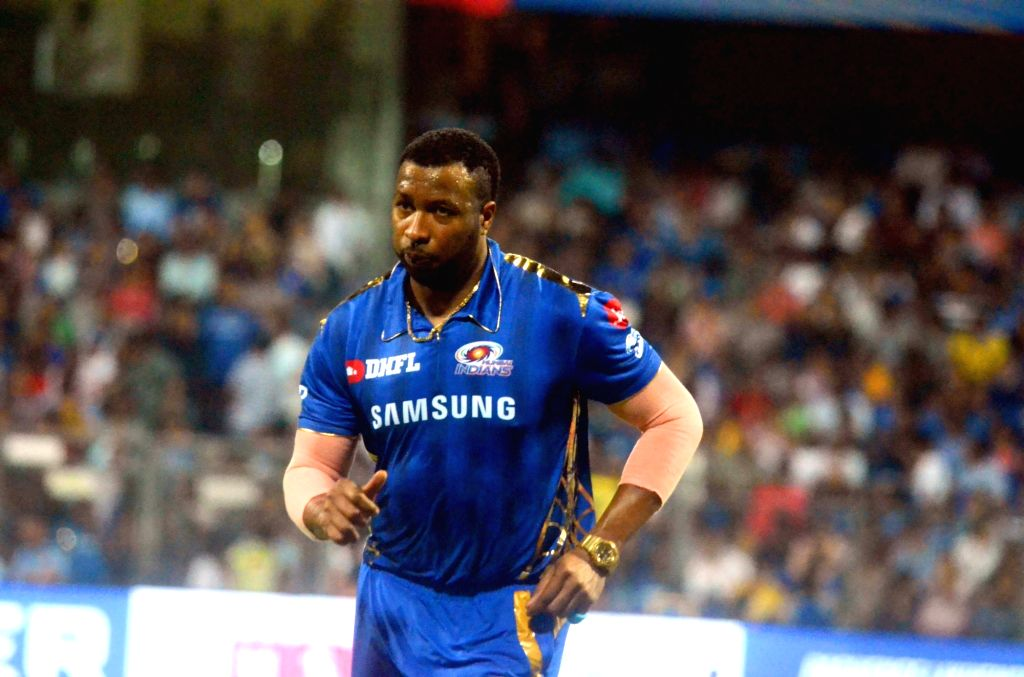 Mumbai: Mumbai Indians' Kieron Pollard during the 24th match of IPL 2019 between Mumbai Indians and Kings XI Punjab at Wankhede Stadium in Mumbai on April 10, 2019. (Photo: Sandeep Mahankal/IANS)