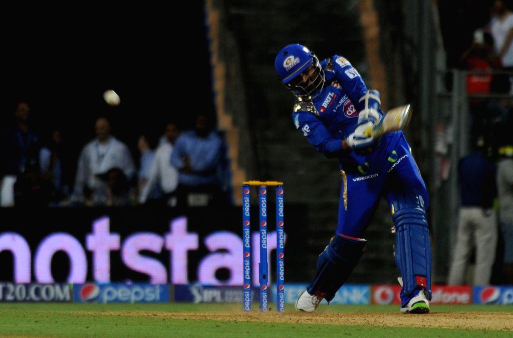 Mumbai Indians player Harbhajan Singh in action during an IPL-2015 match between Mumbai Indians and Kings XI Punjab at Wankhede Stadium, in Mumbai, on April 12, 2015. - Harbhajan Singh